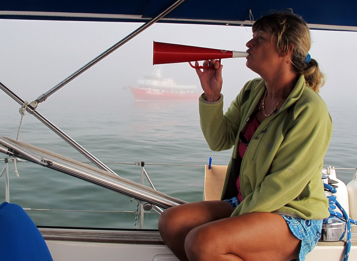 Glenys blowing our pathetic foghorn, Mystic, Connecticut