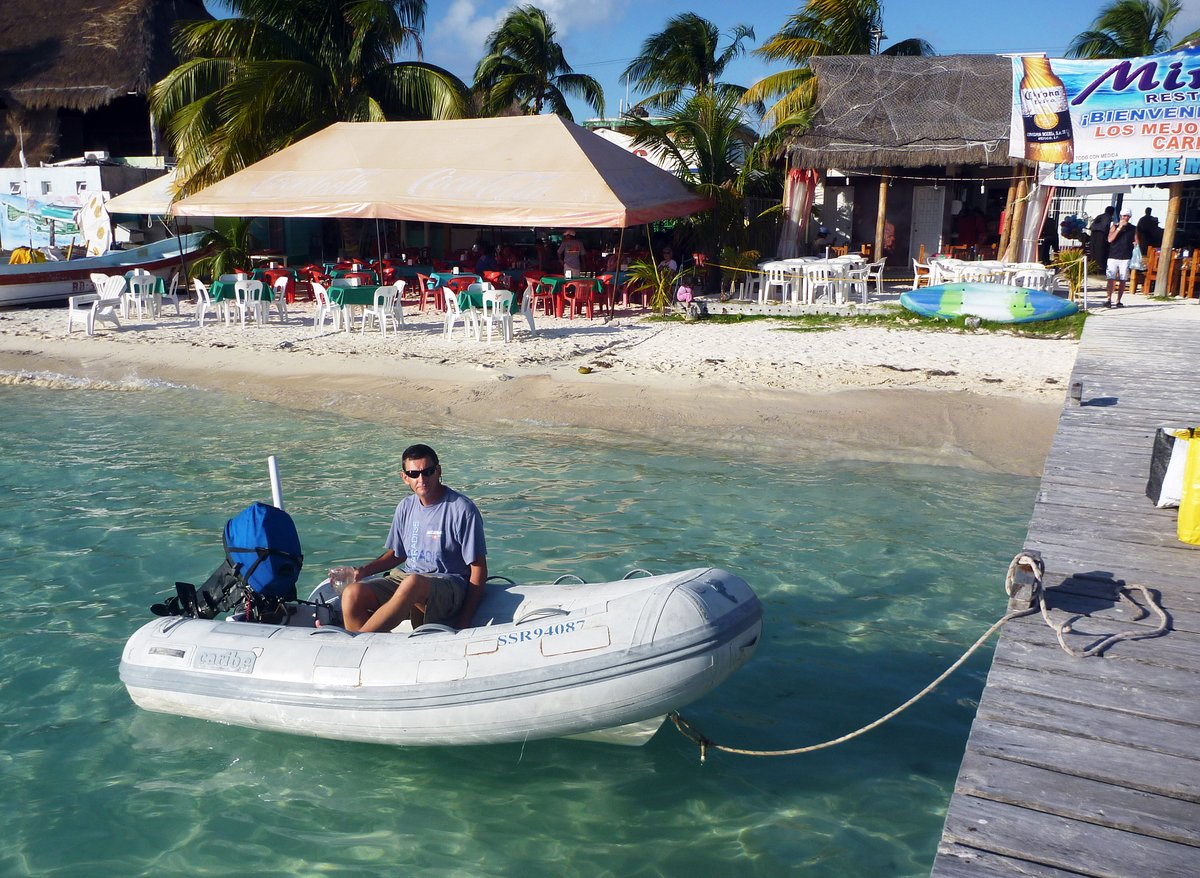Bailing out the dinghy, Isla Mujeres, Mexico