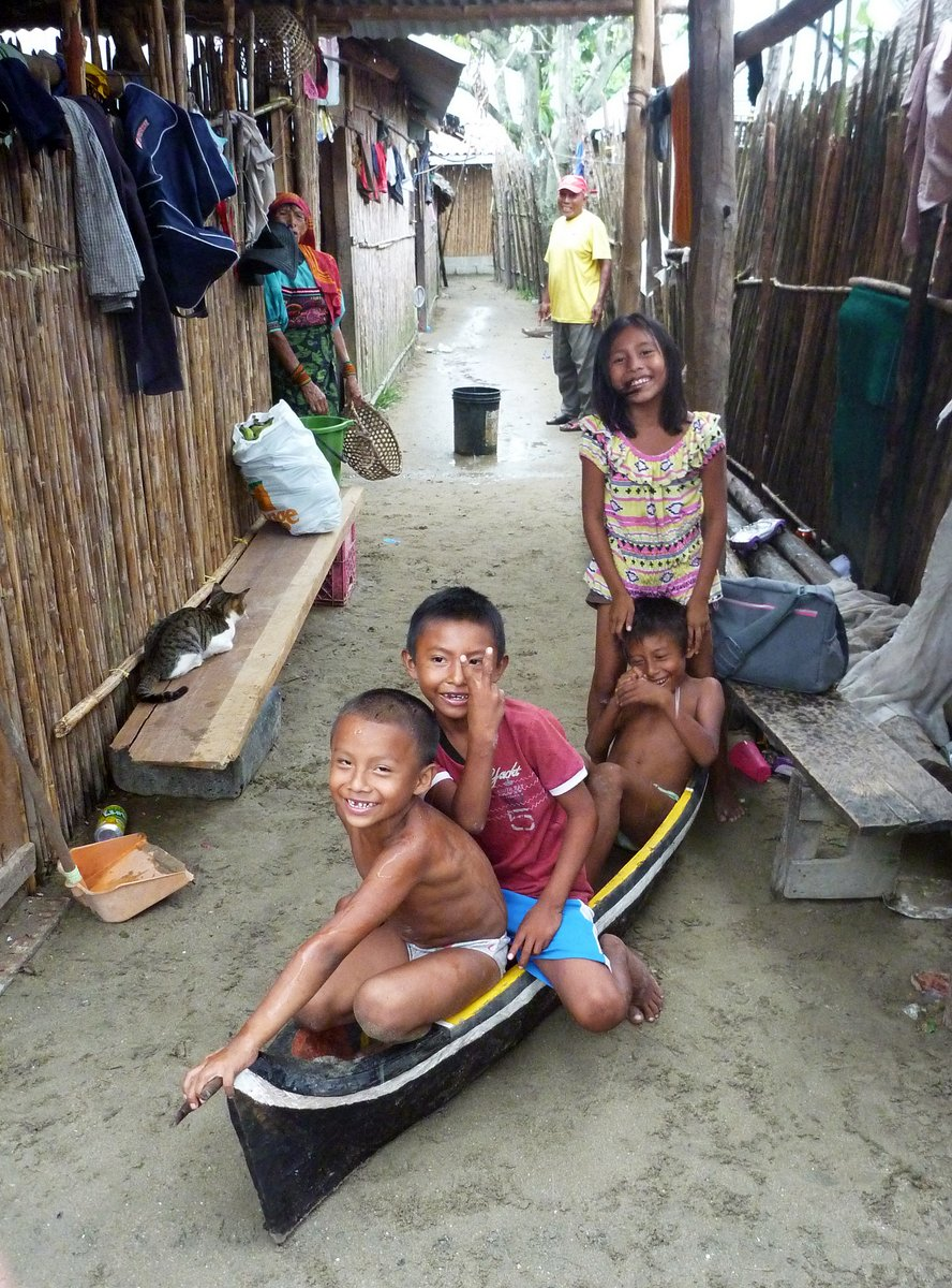 Kids play in their toy dugout canoe, San Blas