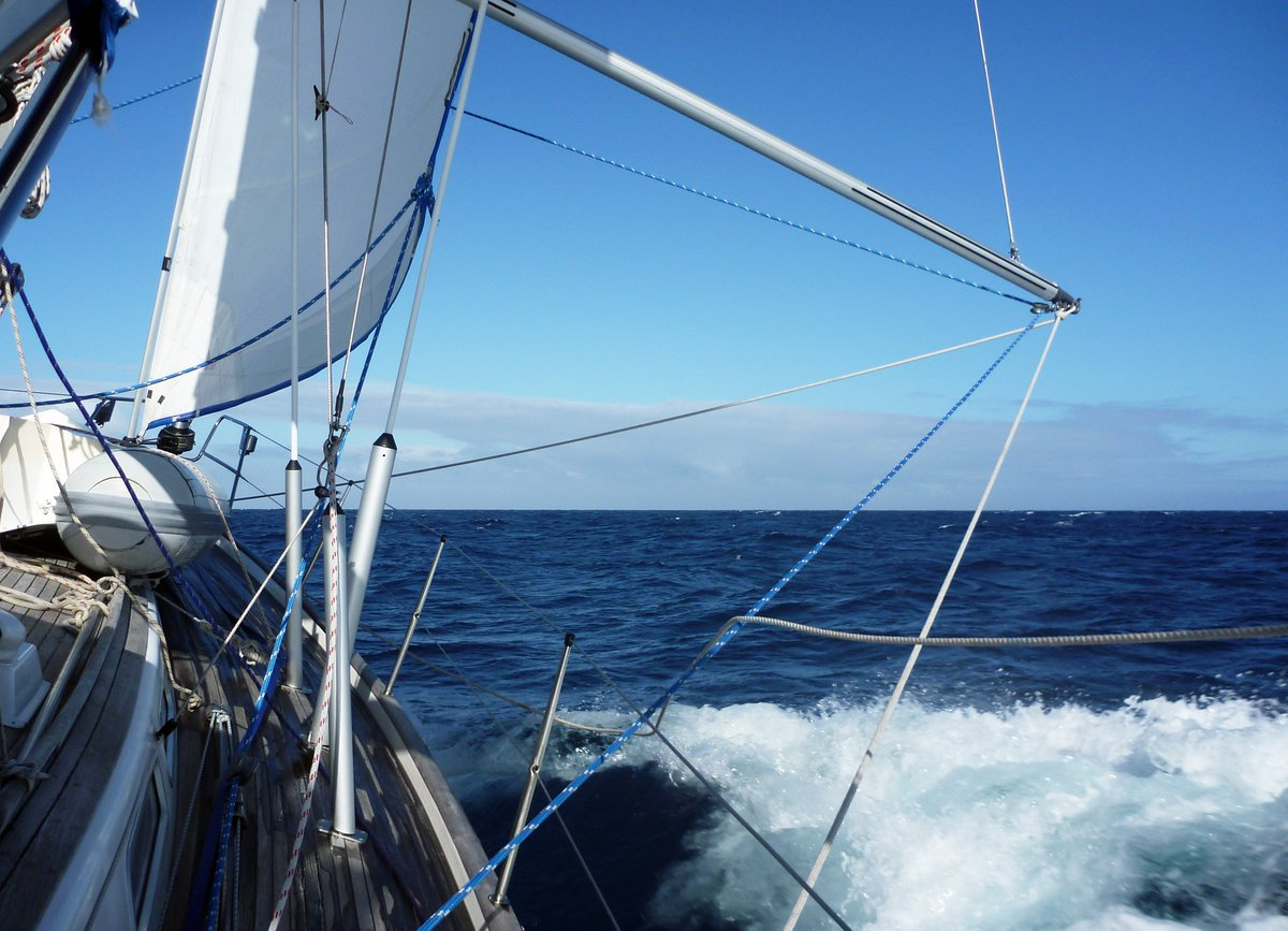 Romping along with a heavily reefed main and stay sail