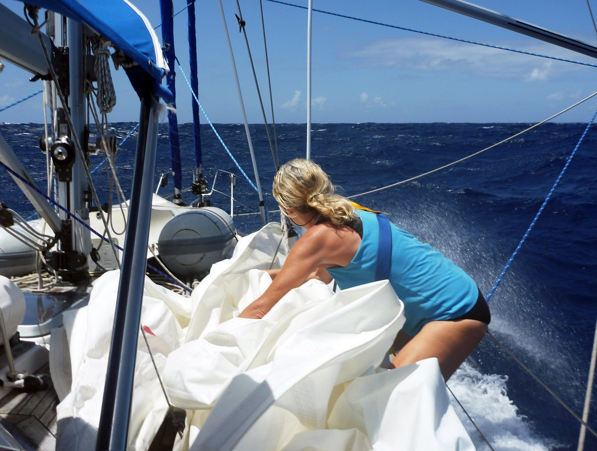 Struggling in strong winds to get the mainsail down