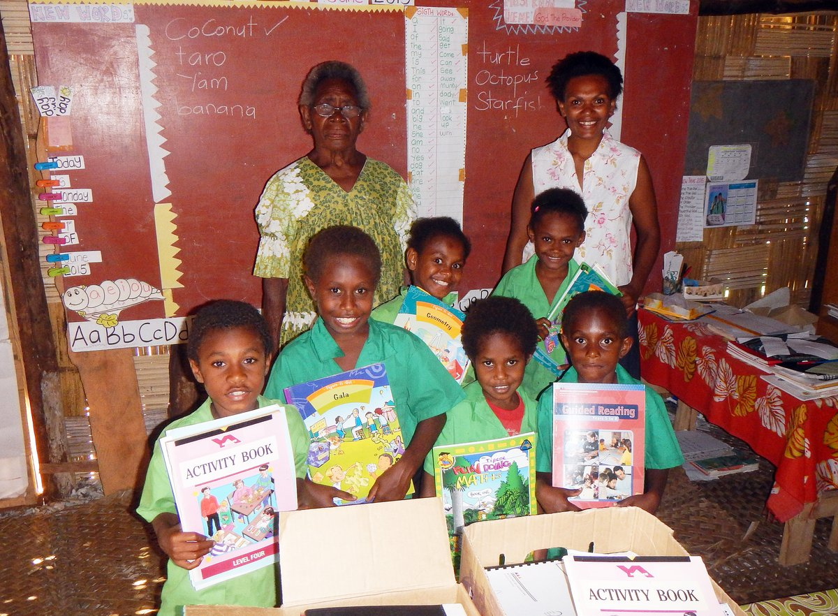 Priscilla, Angela and kids with their new school books