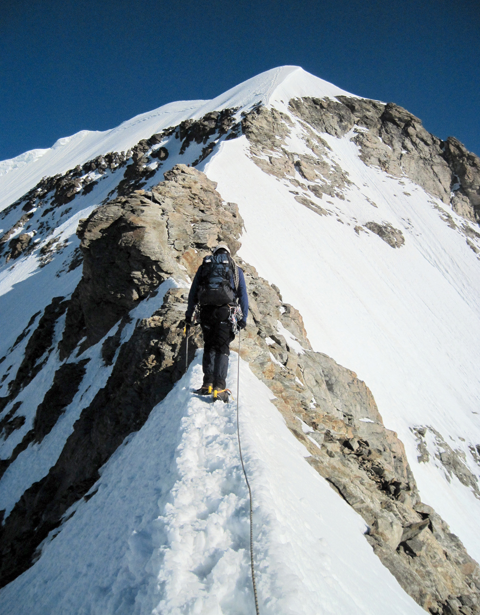 Walking up a steep, narrow arête